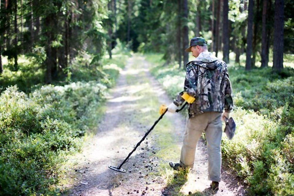 Treasure hunter with metal detector