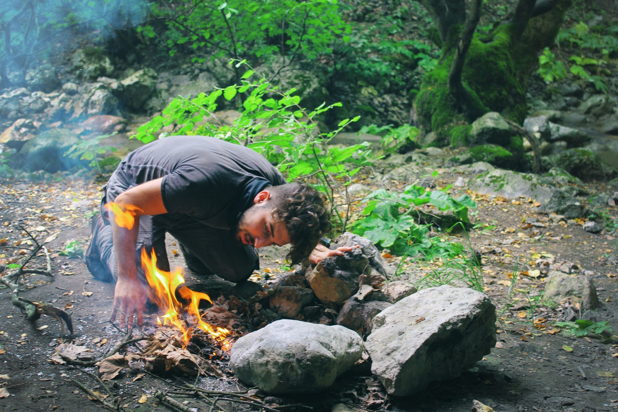 Man starting a fire in the wilderness