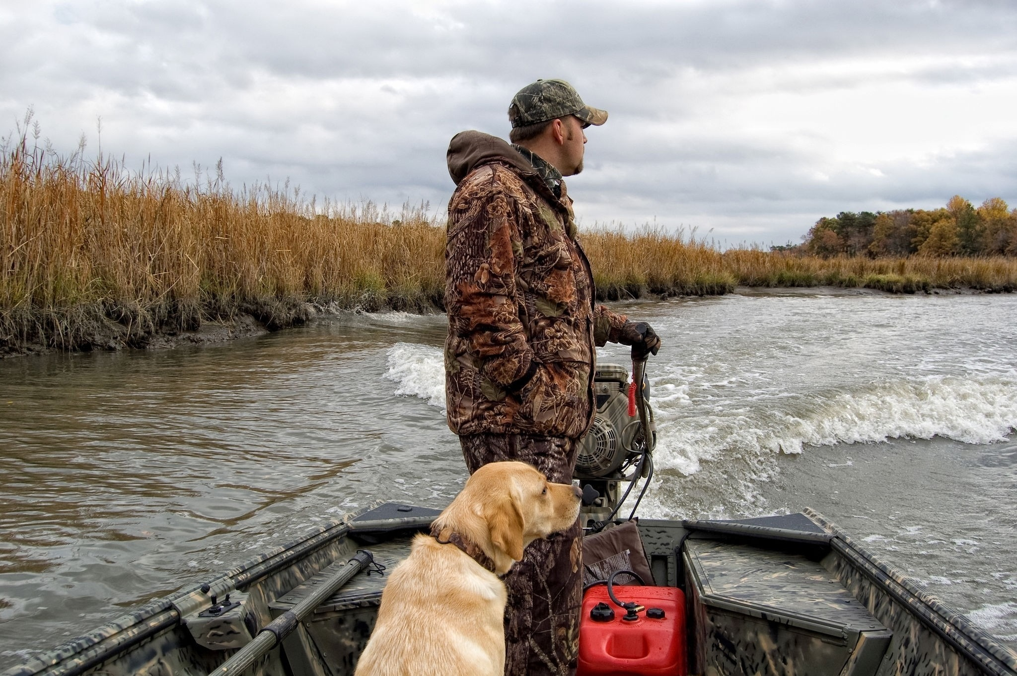 What safety precautions should you take when hunting from a boat